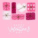 De groetkaart van de valentijnskaartendag met giften stock afbeeldingen