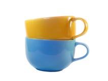 De grote gele en blauwe kop van de soepblik Stock Fotografie
