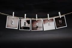 De hängande fotona Fotografering för Bildbyråer