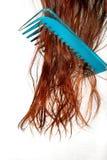 De haarborstel in haar Stock Afbeelding
