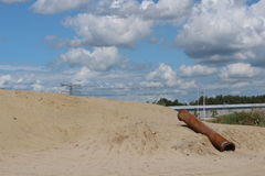 Old sewer pipe. Left over on the beach called Haariijnse plas in Utrecht. The Netherlands Stock Image