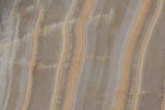 De halfedeltextuur van de agaatgem met strepen op het stock fotografie