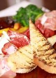 De ham en de toost van Prosciutto Stock Foto