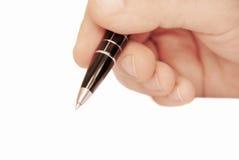 De hand die van de mens op Witboek schrijft Stock Fotografie