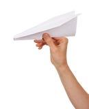 De hand die van de vrouw document vliegtuig werpt Royalty-vrije Stock Foto's
