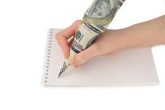 De hand die van de vrouw op papier schrijven Stock Afbeeldingen