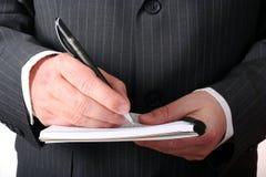 De hand die van de zakenman nota's maakt Stock Afbeeldingen