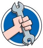 De hand die van het beeldverhaal een moersleutel houdt Royalty-vrije Stock Foto