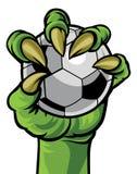 De Hand die van het klauwmonster een Voetbalbal houden vector illustratie