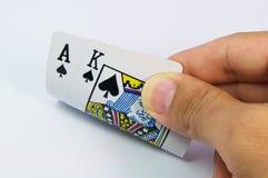 De hand die van Pocker een paar azen toont Royalty-vrije Stock Afbeeldingen
