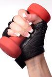 De hand die van Womans een gewicht houdt Royalty-vrije Stock Fotografie