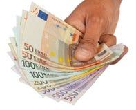 De hand geeft geld Royalty-vrije Stock Foto's