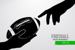 De hand houdt de rugbybal, silhouet Royalty-vrije Stock Foto's