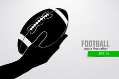 De hand houdt de rugbybal, silhouet Stock Foto