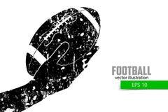 De hand houdt de rugbybal, silhouet Stock Afbeelding