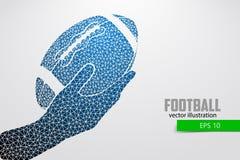 De hand houdt de rugbybal, silhouet van driehoek Royalty-vrije Stock Fotografie