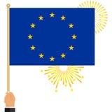 De hand houdt de vlag van de Europese Unie royalty-vrije illustratie