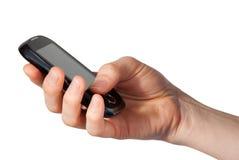 De hand houdt een mobiele telefoon Royalty-vrije Stock Afbeeldingen