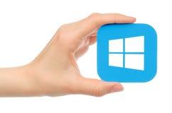 De hand houdt Microsoft Windows op witte achtergrond Stock Afbeelding