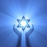 De hand lichte gloed van de jodenster royalty-vrije illustratie