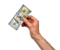 De hand neemt 100 dollarrekening Stock Foto's