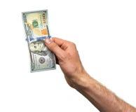 De hand neemt 100 dollarrekening Royalty-vrije Stock Foto's