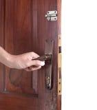 De hand opent de deur Royalty-vrije Stock Foto