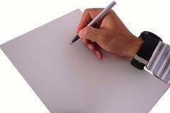 De hand schrijft op het Witboek, op wit wordt geïsoleerd dat Royalty-vrije Stock Foto's
