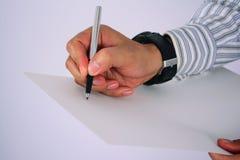 De hand schrijft op het Witboek, op wit wordt geïsoleerd dat Royalty-vrije Stock Foto