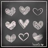 De hand trekt harten op bord Stock Afbeelding