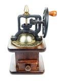 De hand uitstekende oude molenkoffie isoleerde wit Stock Fotografie