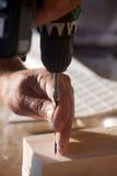 De hand van de arbeider Stock Foto