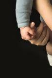 De hand van de baby Stock Foto's