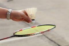 De hand van de badmintonspeler Stock Afbeeldingen