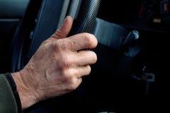 De hand van de bestuurder Stock Foto's