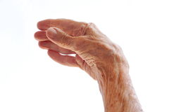 De hand van de hogere vrouw die op wit wordt geïsoleerds stock foto