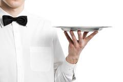 De hand van de kelner met metaalplaat Royalty-vrije Stock Foto