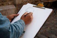 De hand van de kunstenaar Stock Foto