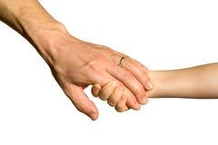 De hand van de papa en van de dochter Stock Foto
