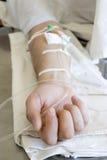 De hand van de patiënt Royalty-vrije Stock Foto's