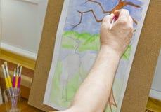 De hand van de schilder Royalty-vrije Stock Afbeeldingen