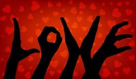 De hand van de silhouetvrouw De liefde van Word Stock Foto