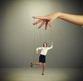 De hand van de vrouw het manipuleren marionet Royalty-vrije Stock Foto
