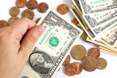 De hand van de vrouw houdt een één dollarrekening op witte achtergrond Royalty-vrije Stock Foto