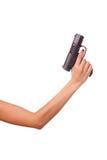 De hand van de vrouw met een kanon Stock Fotografie