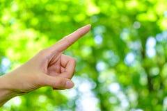 De hand van de vrouw met het richten van vinger Stock Fotografie