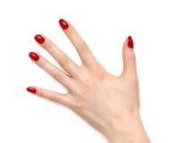 De hand van de vrouw met rode spijkers royalty-vrije stock fotografie