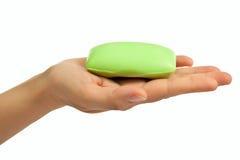 De hand van de vrouw met zeep Stock Afbeelding