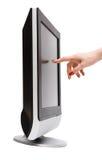 De hand van de vrouw wat betreft het TVscherm Stock Afbeelding