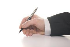 De hand van de zakenman het ondertekenen royalty-vrije stock foto
